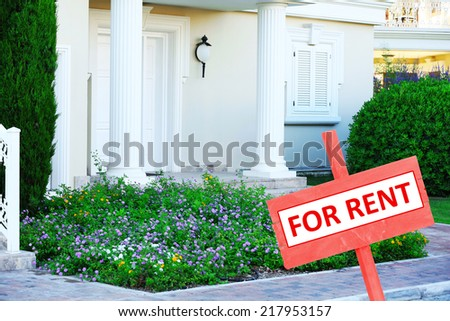 Real estate sign in front of new house for rent #217953157