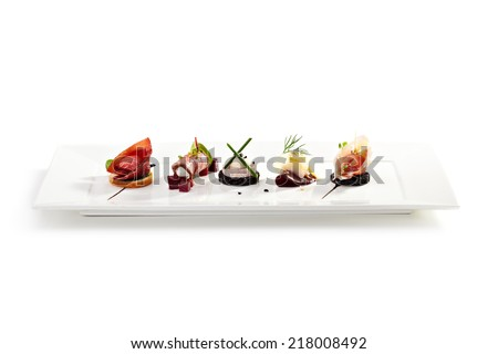 Meat Canapes on White Dish Royalty-Free Stock Photo #218008492