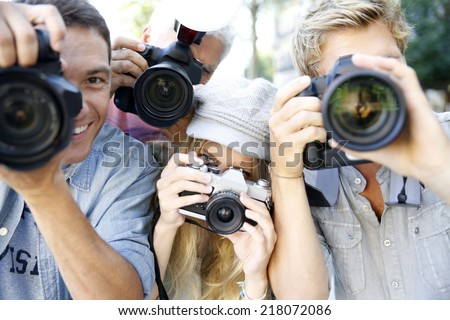 Group of paparazzi people taking picture