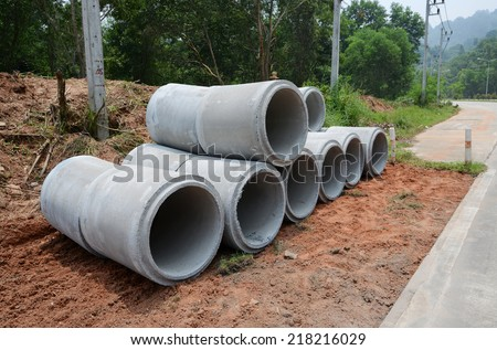 Stacked concrete drainage pipes #218216029