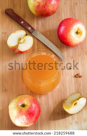 Fresh apples and  handmade juice in a glass on a wooden background #218259688