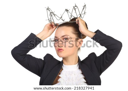 Young beautiful woman trying on crown of barbed wire fence #218327941