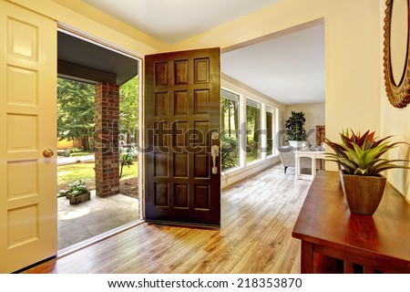 Entrance hallway with cabinet. View of entrance porch through open door #218353870