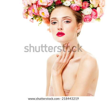fashion model with large hairstyle and flowers in her hair. #218443219