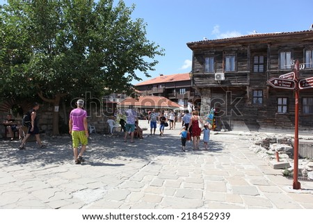 NESEBAR, BULGARIA - AUGUST 29: People visit Old Town on August 29, 2014 in Nesebar, Bulgaria. Nesebar in 1956 was declared as museum city, archaeological and architectural reservation by UNESCO. #218452939