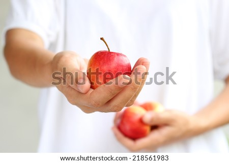 Women hand holding red apple isolated on white background. #218561983