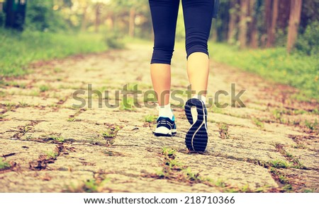 hiking woman legs walking on forest trail  #218710366
