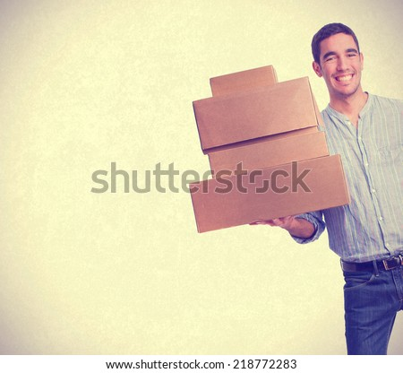 young man with boxes #218772283