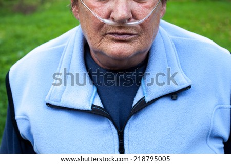 Senior woman with Chronic obstructive pulmonary disease with supplemental oxygen Royalty-Free Stock Photo #218795005