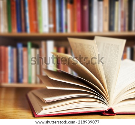 A pile of books with library on the back  #218939077