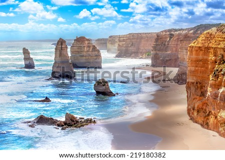 Twelve Apostles and orange cliffs along the Great Ocean Road in Australia Royalty-Free Stock Photo #219180382
