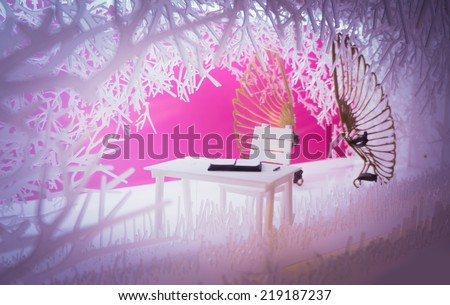 Miniature model of table and chair in romantic atmosphere. Toned picture