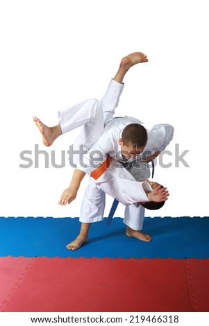 Techniques of throw  in the performance of athletes in judogi #219466318