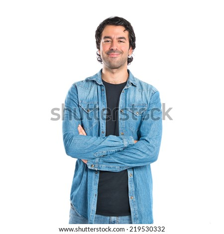 Man with his arms crossed over white background #219530332