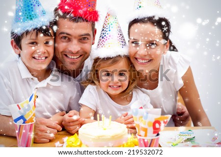 Composite image of Family celebrating daughter against snow falling