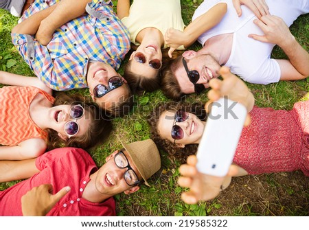 Group of young people having fun in park, lying on the grass #219585322