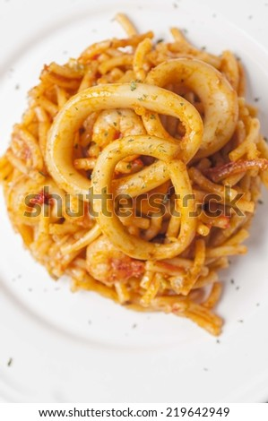 fideua with squid and prawns typical Valencian dish #219642949