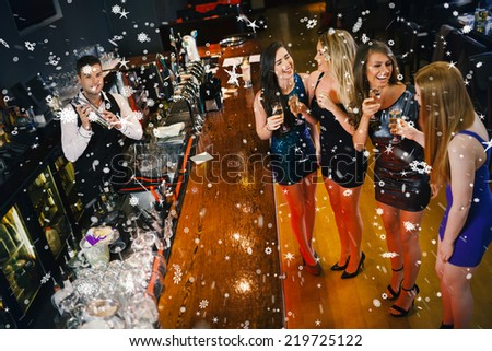Gorgeous women having cocktails together against snow falling #219725122