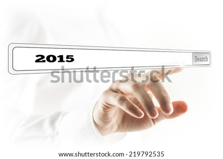 Close Up of Hand Pressing Search Button for 2015 on Touch Screen. #219792535