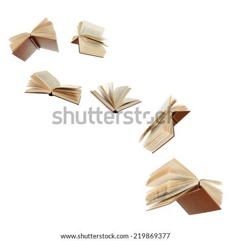 Flying books isolated on white Royalty-Free Stock Photo #219869377