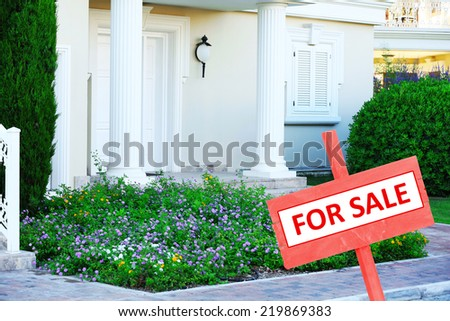 Real estate sign in front of new house for sale #219869383