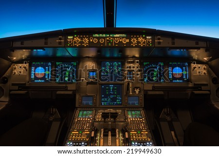 Cockpit view of a commercial jet aircraft cruising at flight level 360. Royalty-Free Stock Photo #219949630