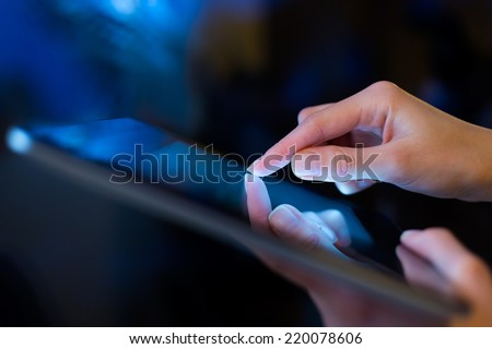 hand presses on screen digital tablet #220078606