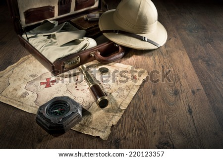 Old treasure map with colonial style pith hat, bras telescope and compass. #220123357