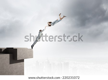 Two young business people flying in sky #220231072