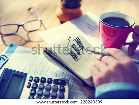 Businessman Working on Project About Business Growth Royalty-Free Stock Photo #220240309