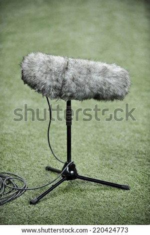 Detail with a professional sport microphone on artificial turf