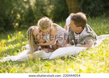 Young family relaxing in garden #220444054