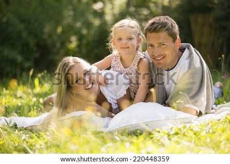 Young family relaxing in garden #220448359