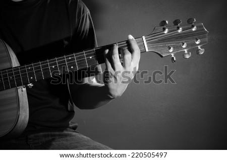 Man playing guitar. Black and white photo. #220505497