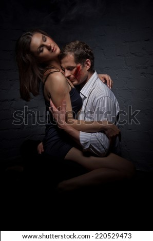 Couple passionately in love. After the fight, and a strong moral shock woman heals the wounds of her beloved hero man. #220529473