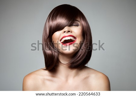 Smiling Beautiful Woman With Brown Short Hair. Haircut. Hairstyle. Fringe. Professional Makeup. Royalty-Free Stock Photo #220564633