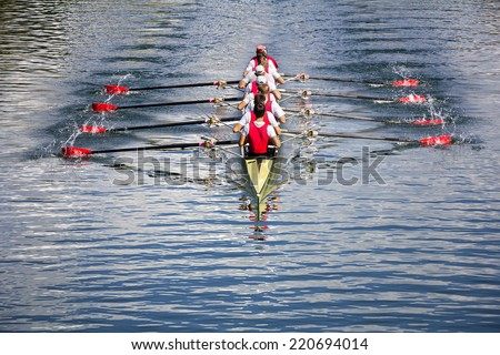 Rowers in eight-oar rowing boats on the tranquil lake Royalty-Free Stock Photo #220694014