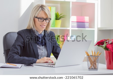 Young professional woman working with computer #221065702