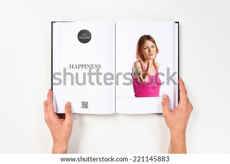 Pretty young woman winner printed on book #221145883