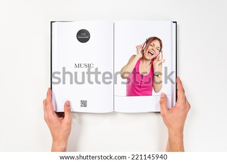 Young girl listening music printed on book #221145940