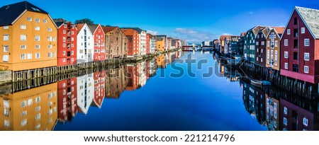 Panoramic view from bridge to famous wooden colored houses in Trondheim city, Norway - architecture background