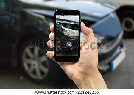 Man photographing his vehicle with damages for accident insurance with smart phone