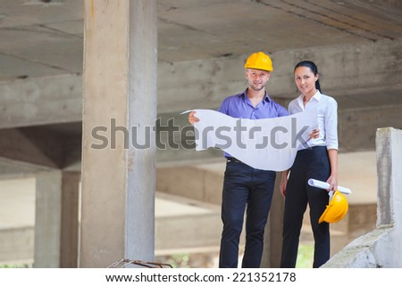 Construction manager and engineer woman working on building site #221352178