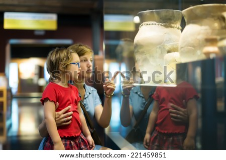 mother and child looking ancient amphores in  museum Royalty-Free Stock Photo #221459851