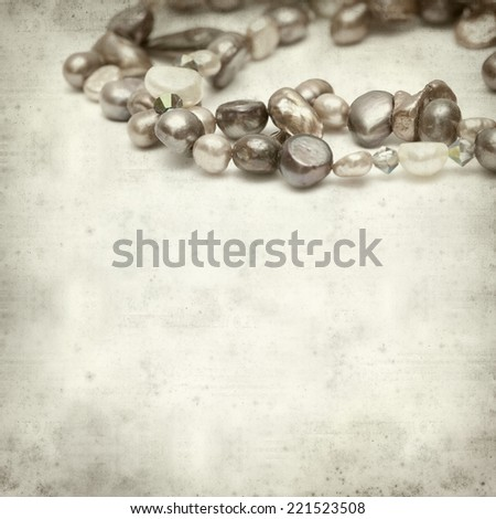 textured old paper background with strings of freshwater pearls #221523508