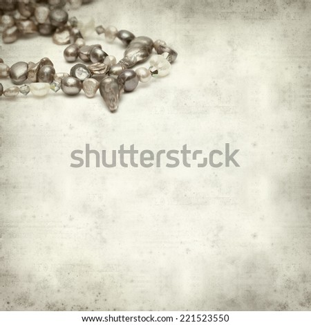 textured old paper background with strings of freshwater pearls #221523550