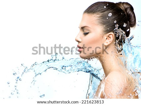 Beautiful Model Woman with splashes of water in her hands. Beautiful Smiling girl under splash of water with fresh skin on white background. Skin care, Cleansing and moisturizing concept. Beauty face  #221623813