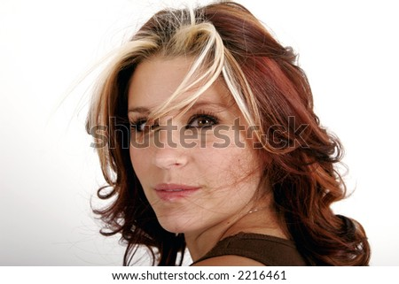 Closeup of a pretty young woman with hair blowing across her face #2216461