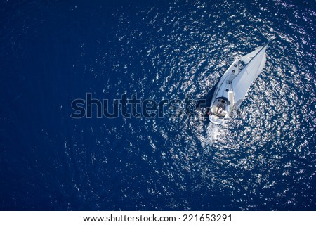 Amazing view to Yacht sailing in open sea at windy day. Drone view - birds eye angle Royalty-Free Stock Photo #221653291