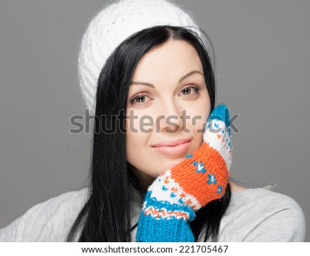 Winter Beauty Woman. Fashion Girl Concept. Skin and hair care in cold season. Beautiful woman with long hair wearing a sweater, scarf, hat and gloves. Holiday Fashion Portrait. #221705467
